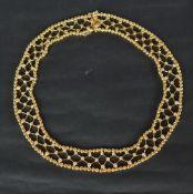 An 18ct yellow gold diamond set necklace, set with seventy three round brilliant cut diamonds,