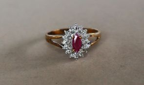 A 9ct yellow gold ruby and diamond cluster ring,