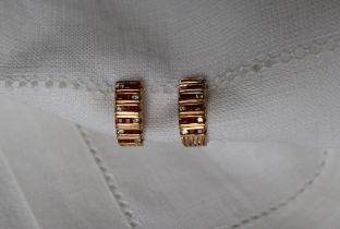 A pair of ruby and diamond hoop earrings,