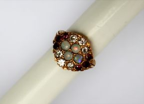 An 18ct yellow gold opal, diamond and ruby ring, set with four round cabochon opals,