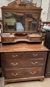 A satin walnut dressing chest, with a rectangular mirror and two drawers,