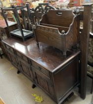 A 20th century oak sideboard together with an oak magazine rack,