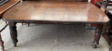 A large Victorian oak extending dining table,