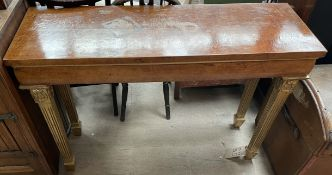 A burr walnut side table on four gilt decorated tapering legs,