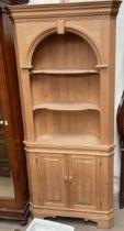 A 20th century pine standing corner cupboard,