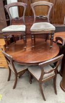 A Victorian mahogany supper table together with a set of six Victorian balloon back dining chairs