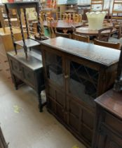 A 20th century oak bookcase together with a dressing chest and an oak occasional table