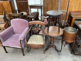 An upholstered elbow chair together with three chairs,