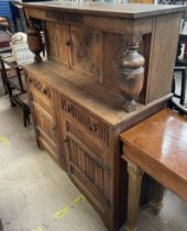 A 20th century oak court cupboard together with a tea trolley, two chairs,