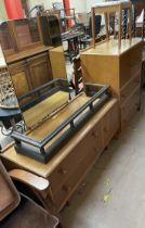A Meredew light oak dressing table with matching tallboy and stool and an oak fire fender