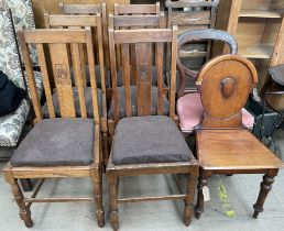 A set of six oak dining chairs together with a Victorian mahogany hall chair and two other chairs