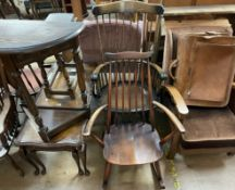 An Ercol stick back elbow rocking chair together with another elbow rocking chair,
