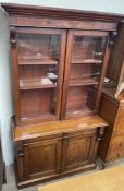 A Victorian mahogany bookcase, with a moulded cornice above a pair of glazed doors,