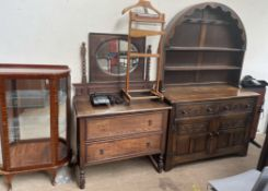 A 20th century oak dresser with a domed top and carved drawers and doors,