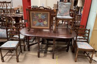 A modern oak drop leaf dining table together with a set of five bar back dining chairs and two fire