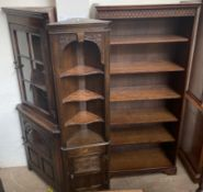 A 20th century oak bookcase together with two oak corner cupboards