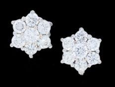 PAIR OF DIAMOND CLUSTER EARRINGS.