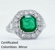 IMPORTANT COLOMBIAN EMERALD AND DIAMOND CLUSTER RING