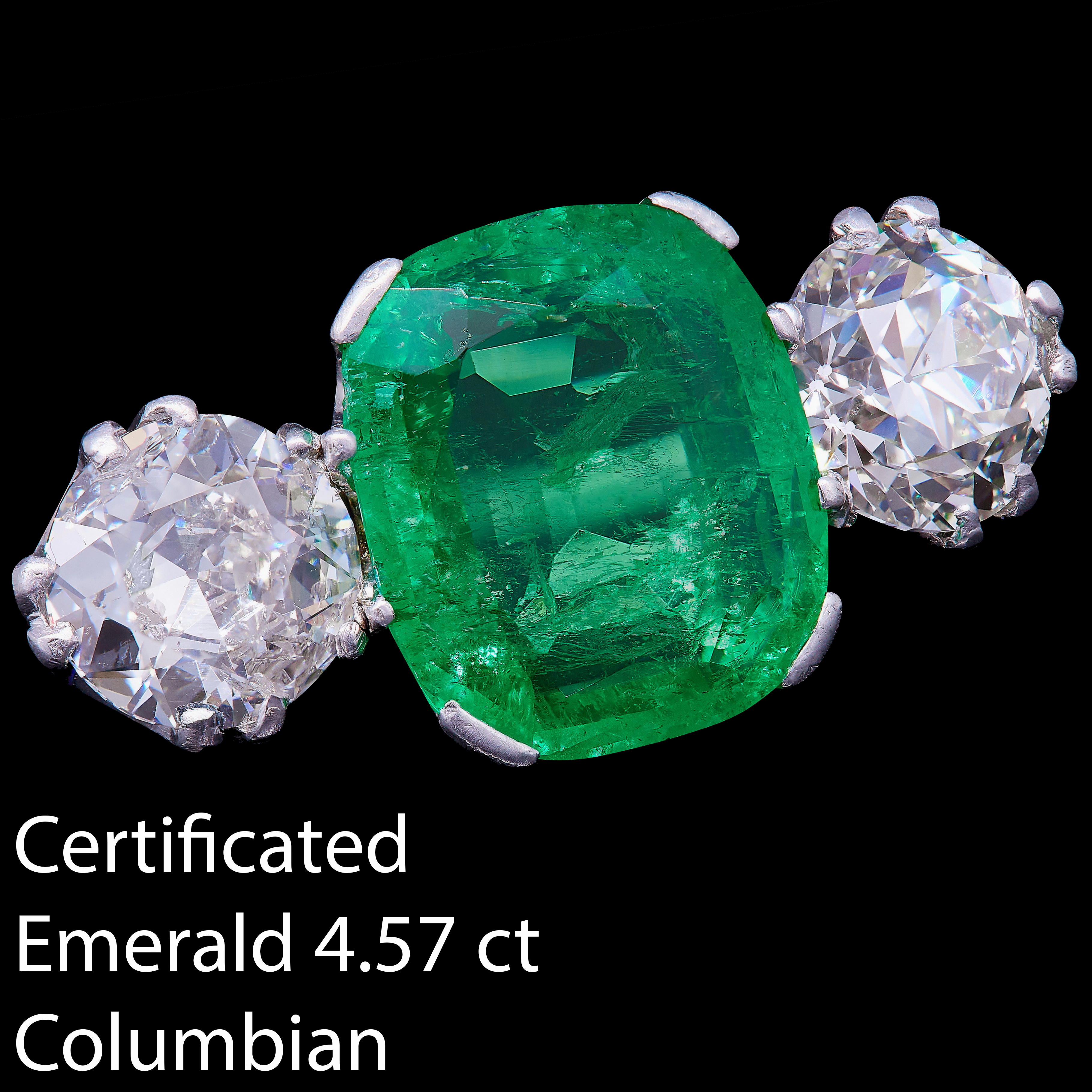 IMPORTANT CERTIFICATED 4.57 CT. COLOMBIAN EMERALD AND DIAMOND 3-STONE RING