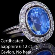 IMPORTANT 6.12 CT. CEYLON BLUE SAPPHIRE AND DIAMOND CLUSTER RING