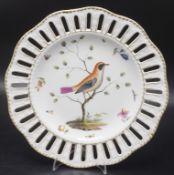 Durchbruchteller mit Vogelmalerei / A reticulated plate with bird painting, Meissen, wohl ...