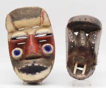 2 masks. Probably West Africa. Also Gaegon, Liberia, Ivory Coast?