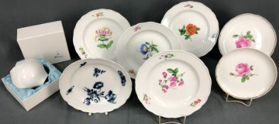 7 Meissen plates. Different decors. Partly with sanding marks.