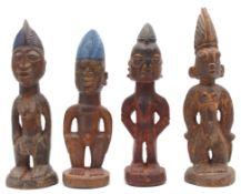 4 figures. Probably Nigeria. West Africa.