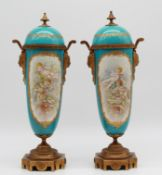 "Two lidded cups around 1900. Porcelain. With ""bronze dore"" mounts."