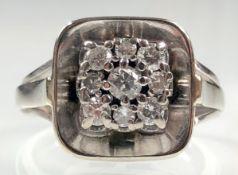 Ring white gold 585. Nine brilliant-cut diamonds - full cut.