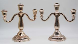 A pair of candlesticks. Silver 835.