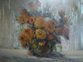 Franz Mortelmans, oils on board, still life of dwarf sunflowers in a vase, signed (62 x 87 cm),