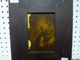 After Austin Osman Spare, an oils on paper laid to board portrait of a scowling man (17 x 12 cm)