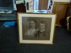 J. Gilbert, a coloured chalk on toned paper portrait of a brother and sister, signed and dated