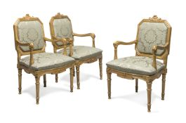 THREE 18TH CENTURY GILTWOOD ARMCHAIRS