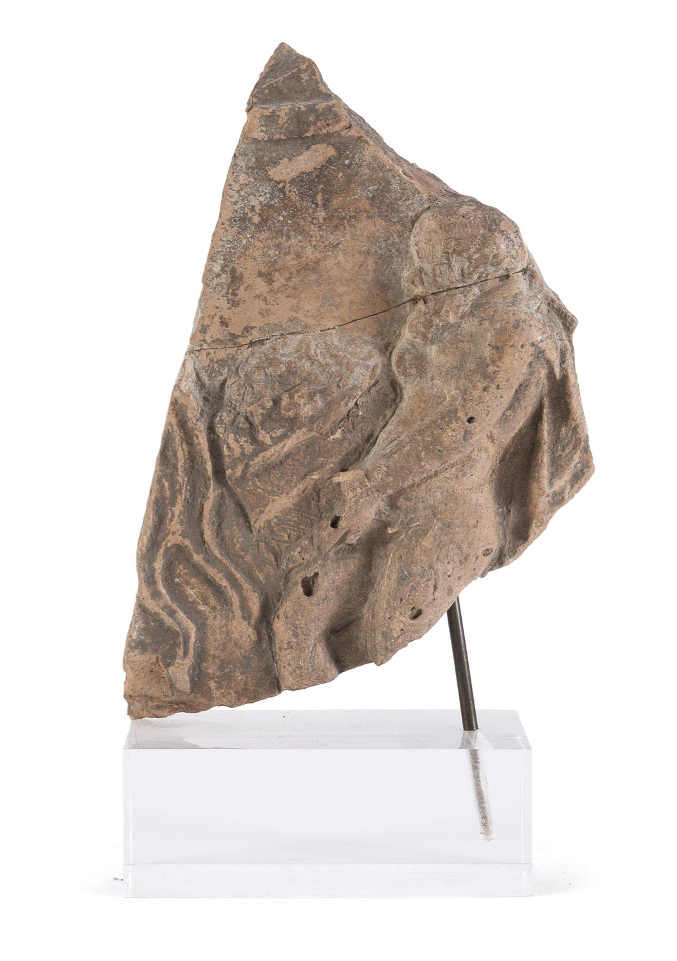 FRAGMENT IN TERRACOTTA 1st-3rd CENTURY AD