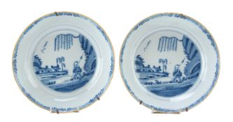 A PAIR OF CHINESE WHITE AND BLUE PORCELAIN DISHES. 20TH CENTURY. DEFECTS AND RESTORATIONS.