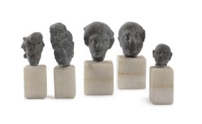 FIVE SMALL SCHIST HEADS GHANDARA STYLE LATE 19TH EARLY 20TH CENTURY.