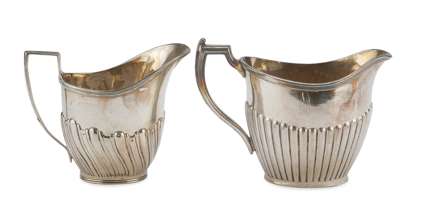 TWO SILVER AND SILVER-PLATED MILK JUGS UK EARLY 20TH CENTURY