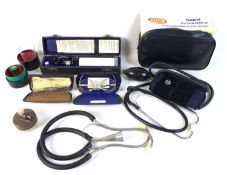 A group of vintage Doctor's GP equipment, including stethoscope, sphygmomanometer, and an