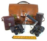 A group of optical instruments, including a pair of black morocco leather bound binoculars, circa