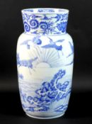 A Japanese Meiji Period porcelain lantern vase, finely decorated in underglaze blue with nine cranes