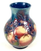A Moorcroft pottery vase, of baluster form, decorated in Finch and Berry pattern, impressed and