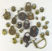 A collection of antique metal and brass padlocks, some with keys, including 'Champion 6-Lever', '
