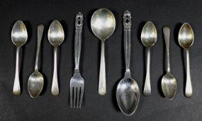 A collection of Danish and British silver flatware, comprising a Georg Jensen Christening spoon,