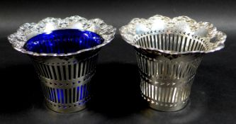 A pair of Edwardian silver baskets, of decagon form with shaped scroll rims and pierced decoration