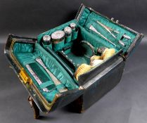 A Victorian/Edwardian Vanity case with silver dressing table wares, featuring three Victorian silver