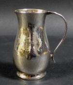 An ERII silver milk jug with planished finish, Howard Jesse Brown, London 1952, 8 by 5.5 by 9cm
