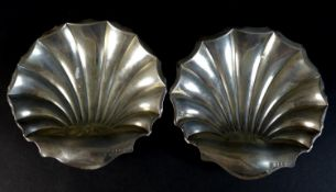 A pair of Edward VII silver dishes, of shell form raised on three ball feet, Atkin Brothers,