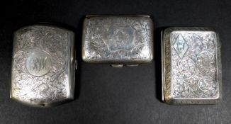 Three Edwardian and later silver cigarette cases, all with parcel gilt interiors, comprising one